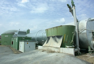 Biogas plant with the biomass supply system visible in the foreground
